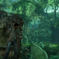 Uncharted Nathan Drake se cache derrière un rocher en pleine jungle