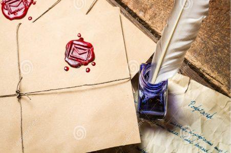 Lettre cachetée et plume d'oie dans un encrier
