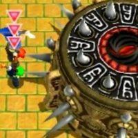 Triforce Heroes Les Link font un totem pour jeter une bombe dans la bouche du Boss