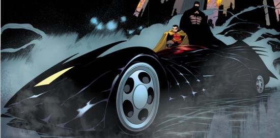 Batman et Robin prennent la pose à côté de la Batmobile