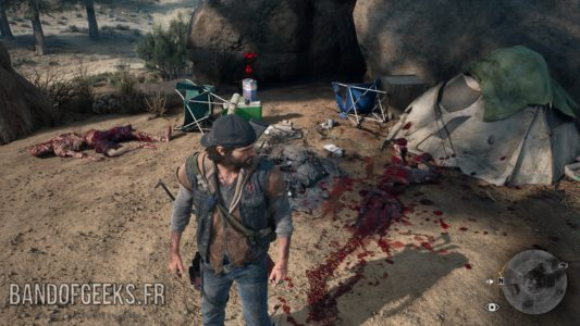 Days Gone Deacon devant un cadavre démembré de campeur